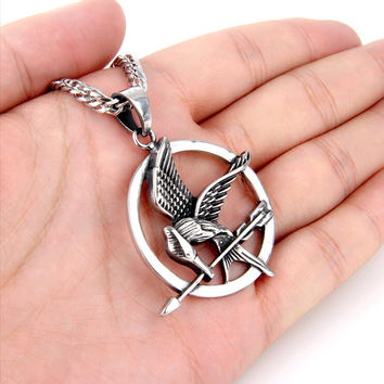 FREE ITEM! Designer Hunger Games Mocking Jay Necklace. Available in three colors for a limited time only!