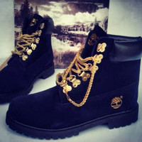 Custom black timberland boots with gold chain laces