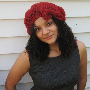 Crocheted cloche hat set with matching fringe scarf in red.