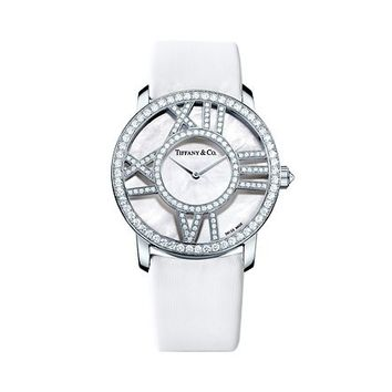 Tiffany & Co. -  Atlas® round cocktail watch in 18k white gold with diamonds, quartz movement.