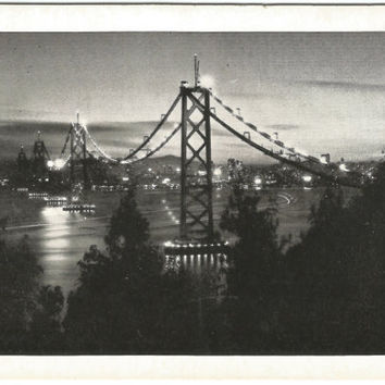 Small Black and White Photograph of San Francisco - Oakland Bay Bridge 1940s by Piggott Photo Vintage Postcard Night Scene