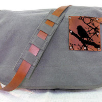canvas messenger bag with leather accents bird in by backerton