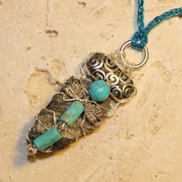Turquoise dragonfly, silver wirewrapped pendant. Uniquely made with a Muskoka Stone and a large beautiful pewter bead.
