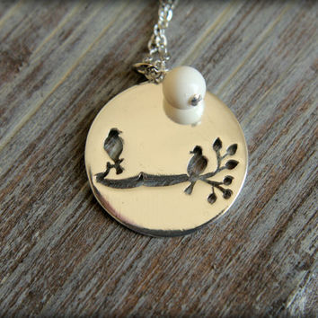 Two Birds on a Branch Cutout Necklace in Silver with Ivory Swaorvski Pearl