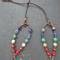 Gemstones in rainbow with leather and copper metal necklace.