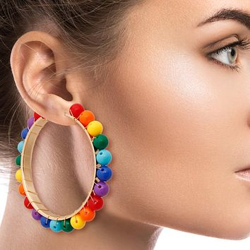 Gold Hoop Earrings Featuring Wire Wrapped Rainbow Bead Detail