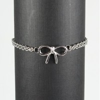 Silver bracelet with bow charm