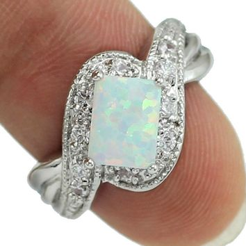 Four Claw Inlay 5x8 MM Princess White Fire Opal Ring