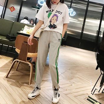 """Adidas "" Women Casual Fashion Cartoon Character Letter Print Short Sleeve T-shirt Stripe Trousers Set Two-Piece Sportswear"