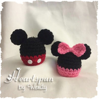 Mickey Mouse or Minnie Mouse EOS Lip Balm Holder with clip to attach to a key chain or bag.  Hand crocheted, fits eos or similar lip balm.