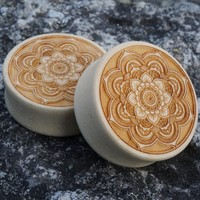 Wooden plugs. 37mm with the flares. Never worn! 100Skr - ...