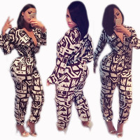 White and Black Long Sleeve Plunge Jumpsuits