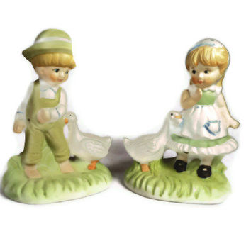 Old fashioned ceramic boy and girl with duck figurines from Brinn's of Pittsburgh