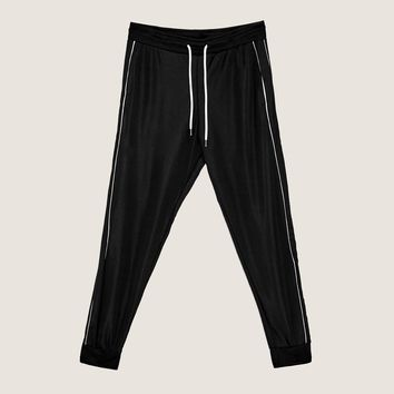 JOGGING TROUSERS WITH PIPED SEAMS DETAILS