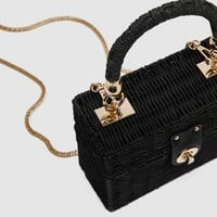 MINAUDIÈRE BAG WITH BRAIDED HANDLE DETAILS