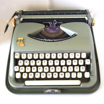 mid century typewriter cole steel abc typewriter vintage industrial decor 1950s 1960sgem bauhaus designed german mid century