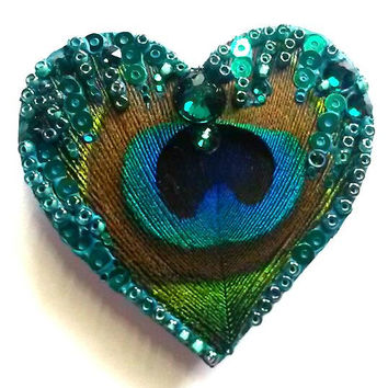 Peacock feather brooch (i) Hand painted wooden heart brooch with peacock feather, glass beads, sequin and Swarovski crystals - by Artichicks