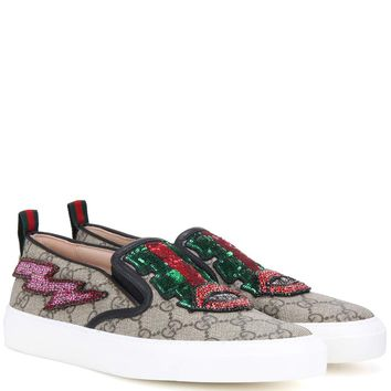 Embellished coated canvas sneakers