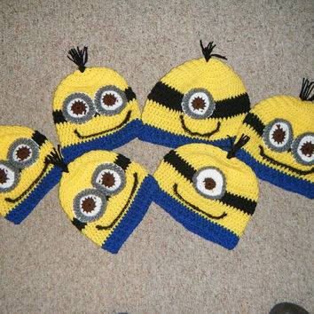 Crocheted Minion hats. Yellow with black band, one or two eyes and bottom blue band.