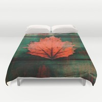 Rusty red dried fall leaf on wooden hunter green beams Duvet Cover by ankka