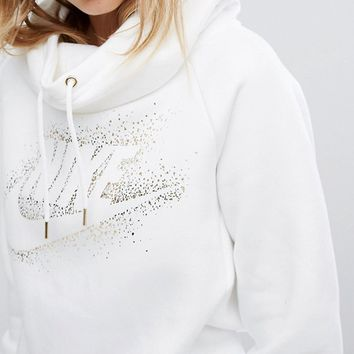 Nike Funnel Neck Hoodie With Metallic Logo at asos.com
