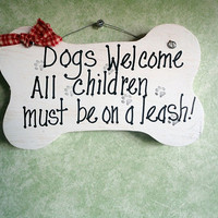 Dogs welcome children must be on a leash wood bone by kpdreams