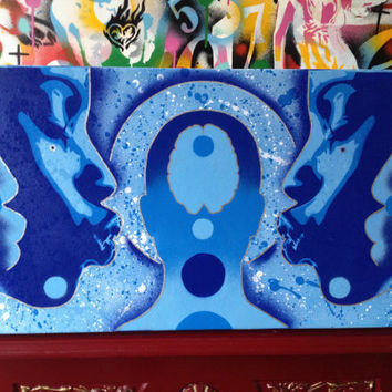 painting of african women in blue on canvas,urban,stencils & spraypaints,symmetry,future,fantasty,sci fi,faces,silhoette,brain,abstract,kiss