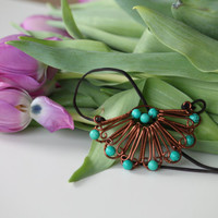 Copper wire wrapped flower pendant with turquoise beaded leaves