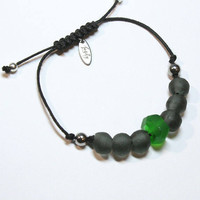 Black and green handmade recycled glass bead bracelet with hematite