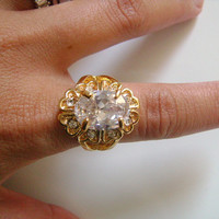 Very Elegant Cocktail Dinner Ring Gold Tone Faceted Oval Cut Prong Set CZ Cubic Zirconia Center Stone Accented Rhinestone Accents Size 7-1/2