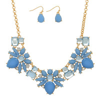 Gold Tone Bib Style Star Burst Necklace and Earring Set Featuring Blue Cabochons