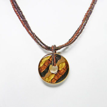 Abstract Medallion Bead Necklace Signed KC Gold Copper Black Brown