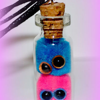 Brand new Monster Barf Item Monster Barf in a bottle Necklace blue and pink