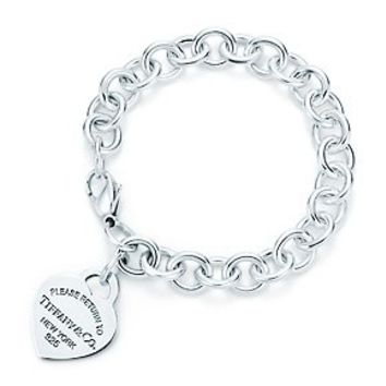 Tiffany & Co. -  Return to Tiffany™ heart tag charm bracelet in sterling silver.