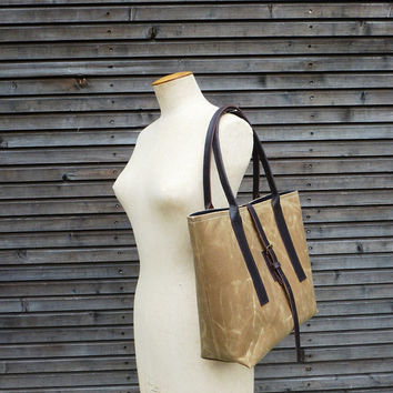 Waxed canvas carry all/ shoulderbag with waxed leather handles and strap COLLECTION UNISEX