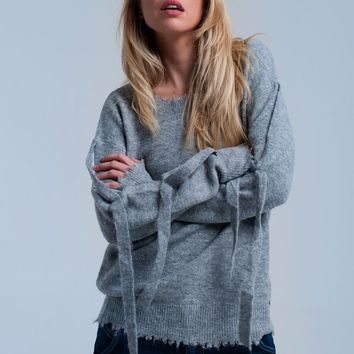 Gray knitted sweater with ribbons