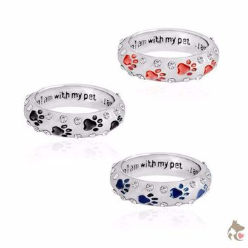 """Beautiful Paw Print And Rhinestone Ring - Engraved With """"When I Am With My Pet.....I Am Complete"""""""