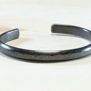 Black sterling silver half round cuff bracelet with hammered texture and intrigue