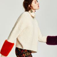 SWEATER WITH CONTRASTING FABRIC CUFFS