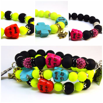 set of 3 beaded charm bracelets, armcandy neon stretch bracelets, 3 Buddha beaded stacking bracelets. mixed metal colors.