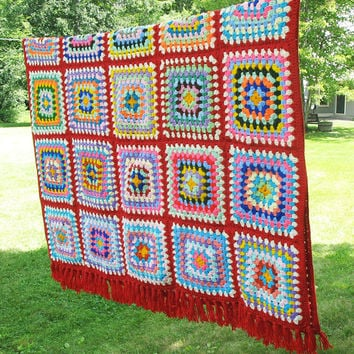 "Colorful vintage crochet afghan blanket throw with multicolored granny squares and red borders and fringes -  71"" x 52"""