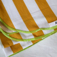 Baby swaddling blanket. Gender neutral- mustard and white with green edging.   Made by lippy brand.