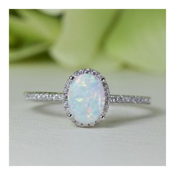 Halo Oval Cabochon Lab-Created Opal And Cubic Zirconia Ring in Sterling Silver