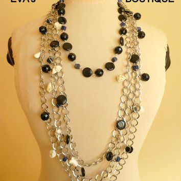 Unique and very large statement bib necklace with white onyx, black agate, lapis lazuli, white howlite beads mixed with silver plated chain