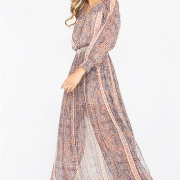 Boho chic Maxi dress featuring a paisley pattern on gauze chiffon fabric, a deep v-neckline with 3 button closure, elasticized waist, ruched at yoke and back, semi-sheer long sleeves with elasticized ruched cuffs. Finished with accordion pleated detailing
