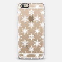 Let it Snow! - White Snowflake Pattern on Crystal Transparent iPhone 6 case by Micklyn Le Feuvre | Casetify