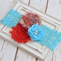 Red and turquoise shabby chic flower with 2 inch stretchy lace headband. Looks beautiful on baby girls, toddlers and adult women. Your Final Touch