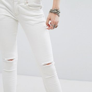 Free People Mid Rinse Skinny Destroyed Ankle Jean at asos.com