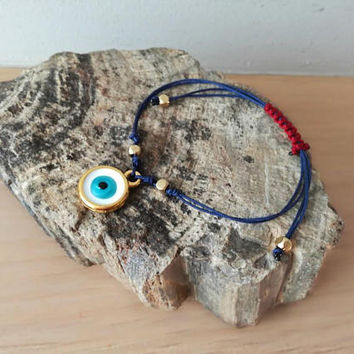 Blue eye bracelet, blue brass eye macrame bracelet, navy blue cuff with brass and enamel evil eye, boho bracelet, Greek blue eye cuff