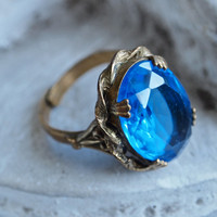 Beautiful Blue 1930's Uncas Oval Glass Stone Ring Marked and Adjustable